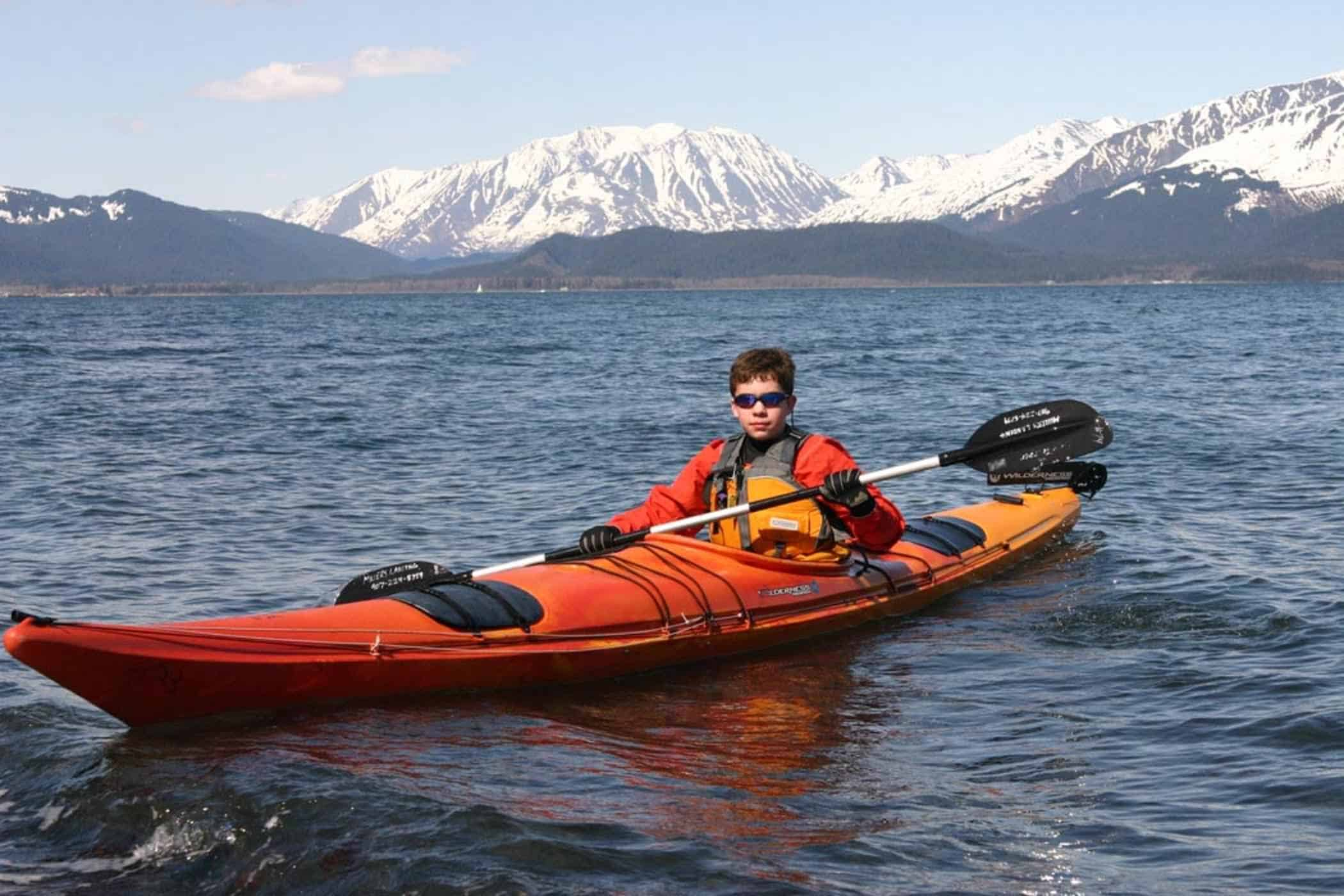 Boy paddling a kayak