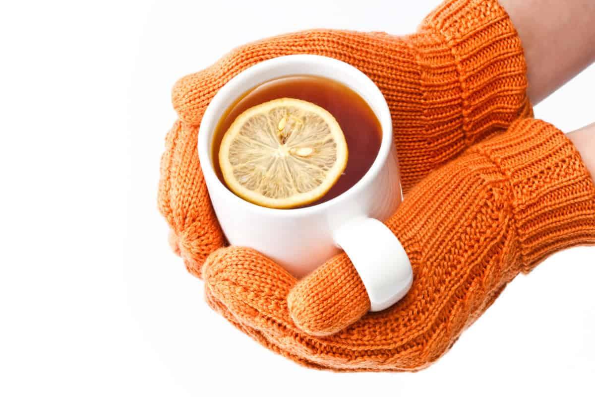 Warming hands on hot drink mug
